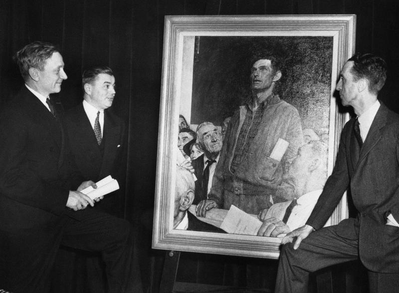 "Justice William O. Douglas of the Supreme Court of the United States admires a painting ""Freedom of Speech"" by artist Norman Rockwell, right, at the national premier of the Four Freedoms War Bond Show in Washington, D.C., on April 26, 1943."