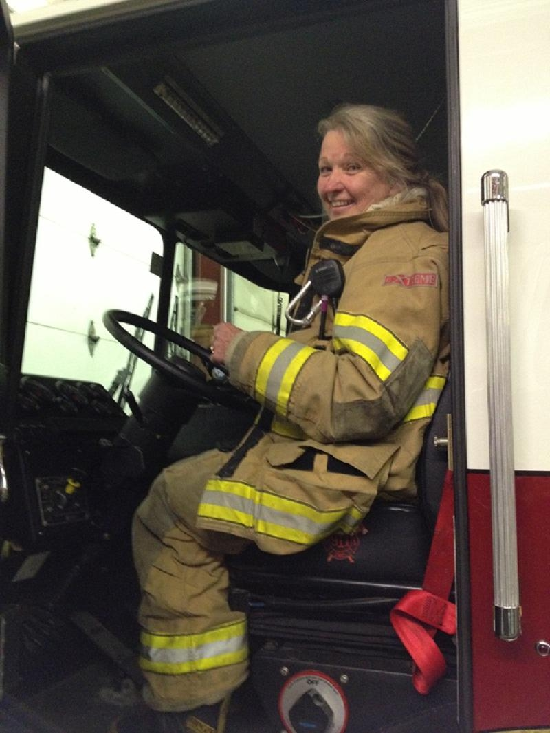 Norwich firefighter Jennie Owens prepares to drive truck for training exercise.