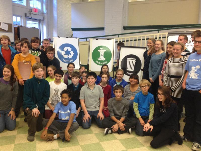 Montpelier's Main Street Middle School Green Team poses with the newly unveiled Universal Recycling symbols.