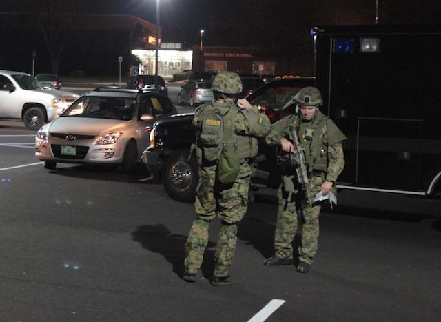Troopers with the Vermont State Police's Tactical Services Unit on the scene at Winooski schools.