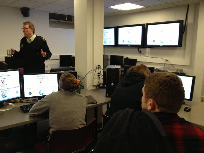 Prof. Peter Stephenson shows cyber-forensics students at Norwich University how to use hard drives to catch criminals.