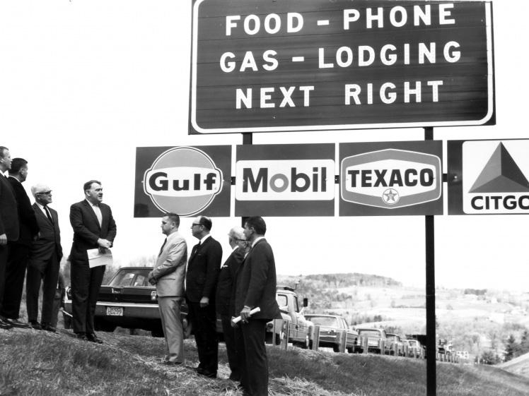 "The back of this 1964 photograph reads, ""Unvailing [sic] of new gas signs on I-89."" An exhibit at the Vermont History Museum features historic photos from before, during and after the construction of the state's interstate highway."