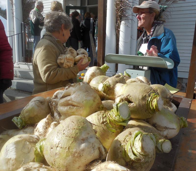 Chris Tarnay sells turnips from a turnip wagon in Wardsboro.