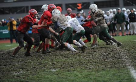 Students play on muddy CVU grass field.