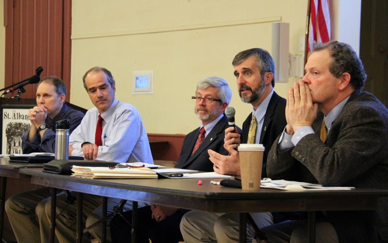 Department of Environmental Conservation Commissioner David Mears (second from right) with Secretary of Agriculture Chuck Ross (right) and EPA officials at a public meeting on Monday.