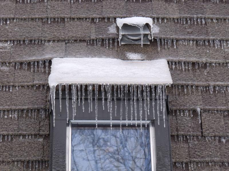 Ice shellacks the side of a house in Essex.