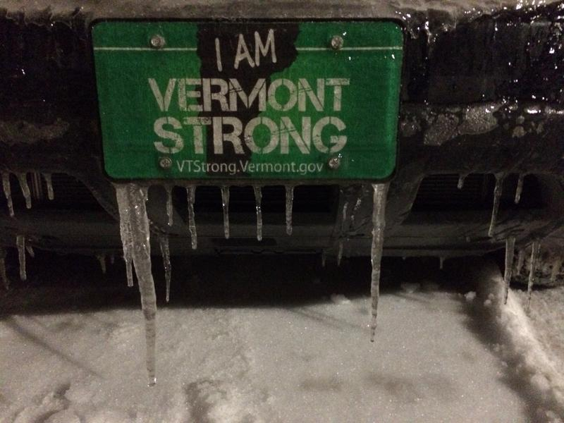 "Icicles hang from an ""I Am Vermont Strong"" license plate in Burlington."