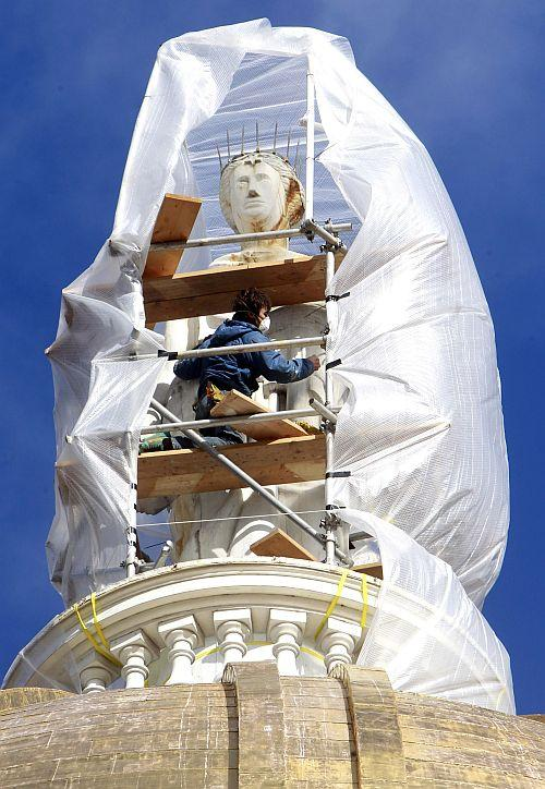 Jake List of Liszt Historical Restoration works on the statue of Ceres atop the Statehouse dome in Montpelier. The Roman goddess of agriculture is getting rehabilitated and a fresh coat of paint. The last work on the goddess was done back in 2004.