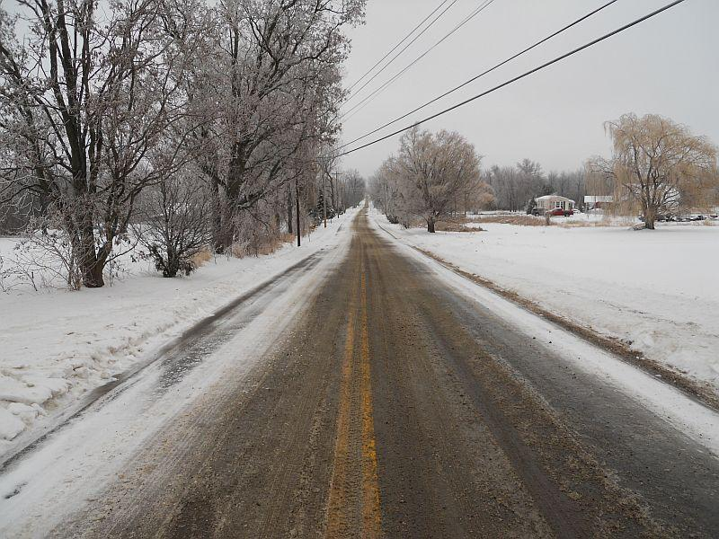 Ice and slush covered the roads in Grand Isle on Sunday morning. This weekend's ice storm left more than 10,000 people without power.