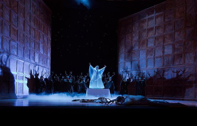 "A scene from Verdi's ""Falstaff"" with Lisette Oropesa (center in white) in the title role."