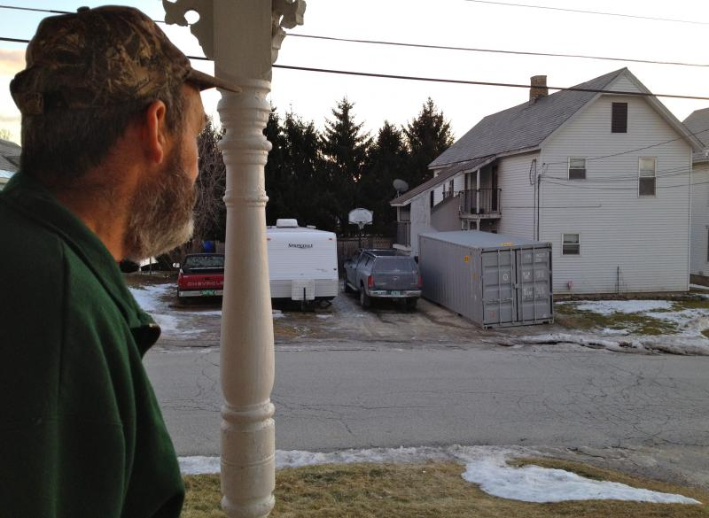 Neil Whitney gazes across the street at the house he and his wife shared for over twenty years.  Last April, an exterminator hired by the state allegedly treated the home with the banned pesticide Chlorpyrifos making the home unsafe to live in.