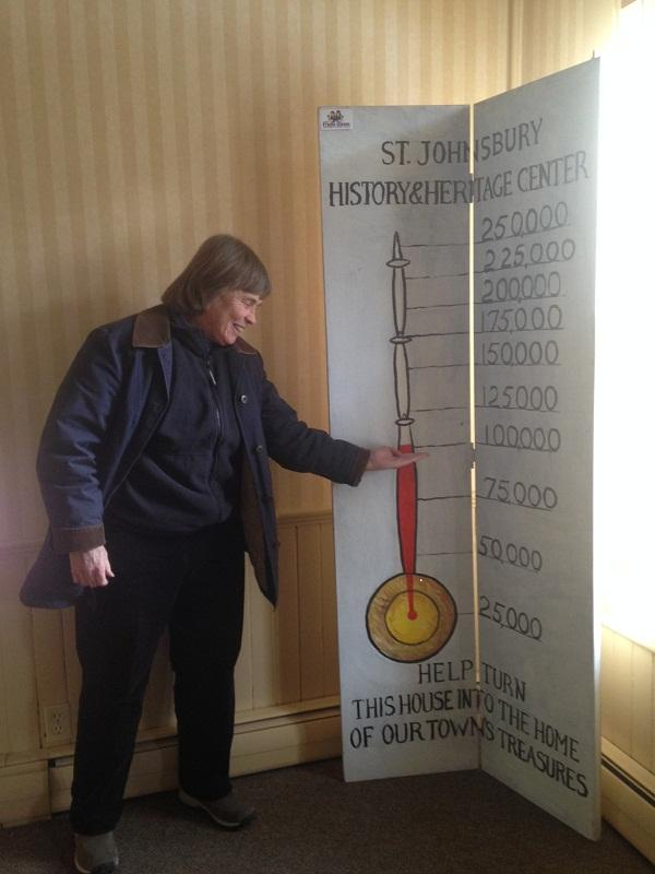 Peggy Pearl, director of St. Johnsbury History and Heritage Center, shows progress in fundraising drive for new building.