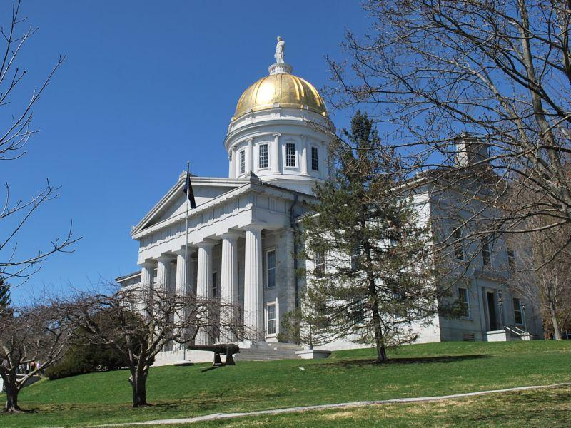 The exterior of the Vermont Statehouse in Montpelier on a blue-sky day.