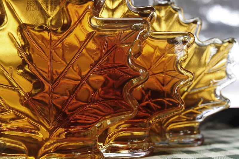 Maple syrup in glass leaf-shaped bottles.