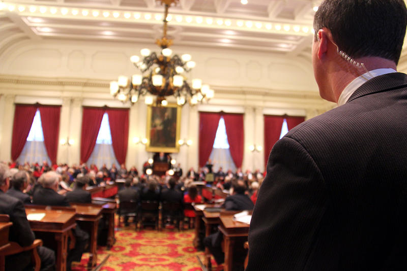 A member of Gov. Shumlin's State Police security detail looks on during Wednesday's address.