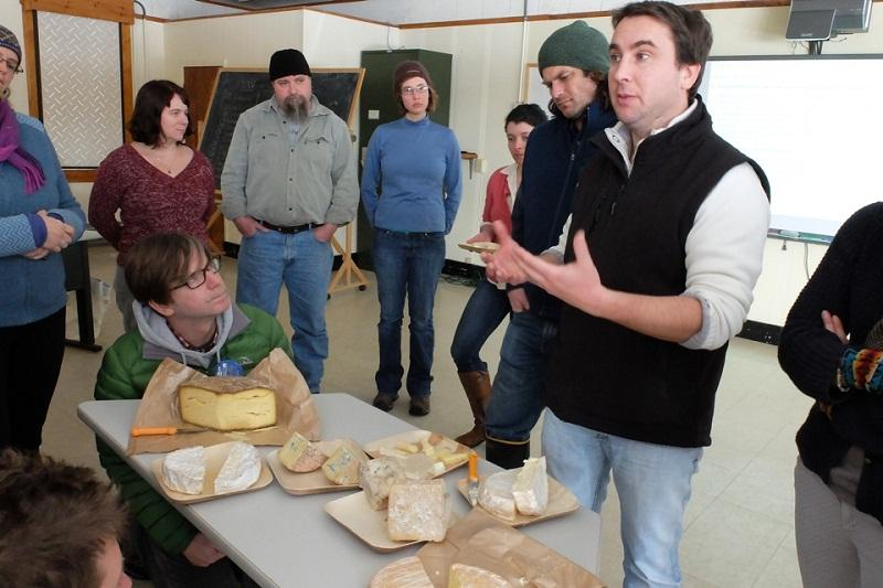 Ivan Larcher displays cheese samples for class at Sterling College.