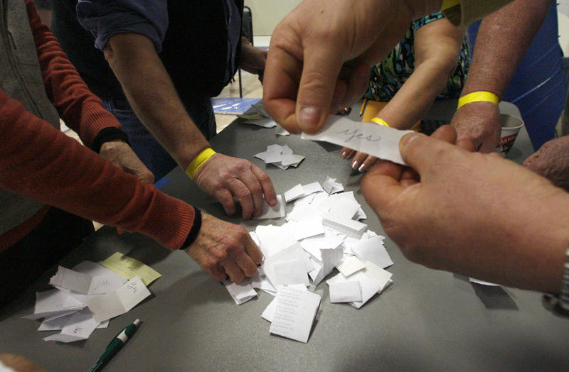 Officials count a paper ballot vote during the 2013 Town Meeting in Craftsbury.