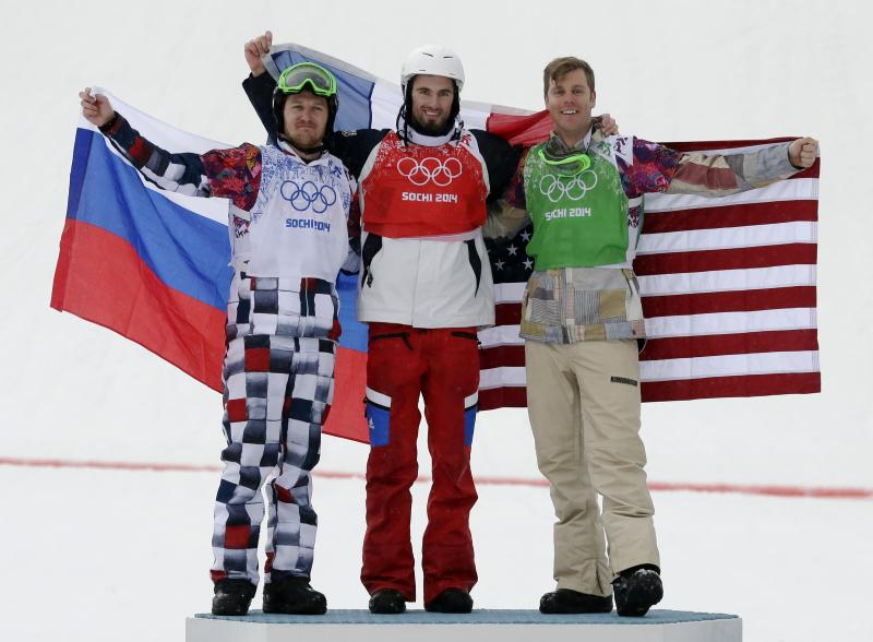 Alex Deibold of Manchester Center, right, celebrates his bronze medal in Snowboard Cross with gold medalist Pierre Vaultier of France, center, and silver medalist Nikolai Olyunin of Russia on Feb. 18.
