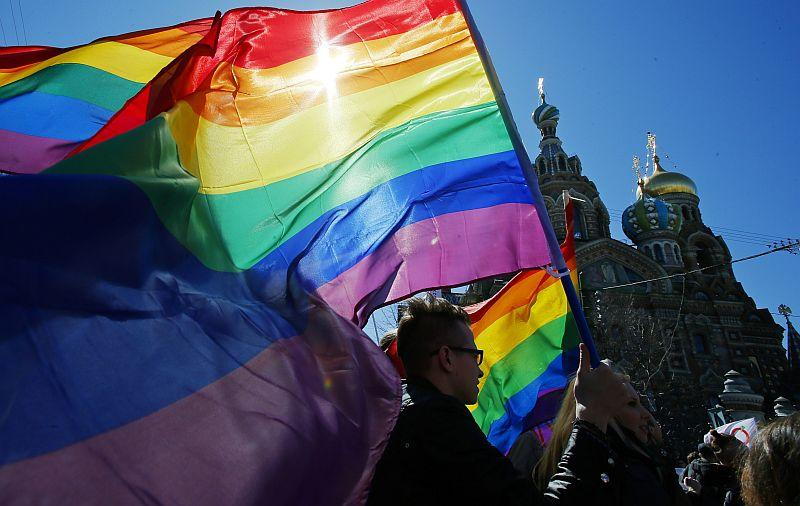 Gay rights activists carry rainbow flags as they march during a May Day rally in St. Petersburg, Russia in 2013.