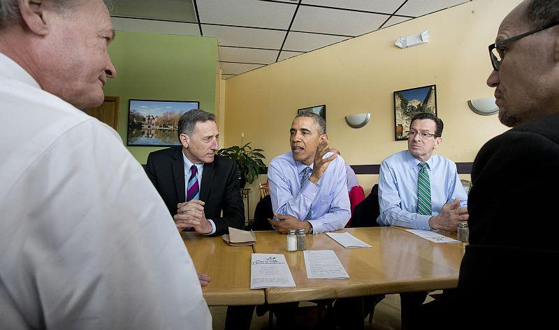 President Barack Obama, center, sits down for lunch with from l-r, Rhode Island Gov. Lincoln Chafee, Vermont Gov. Peter Shumlin, Connecticut Gov. Dannel P. Malloy and Labor Sec. of Labor Thomas Perez at a cafe in New Britain, Conn., on March 5, 2014.