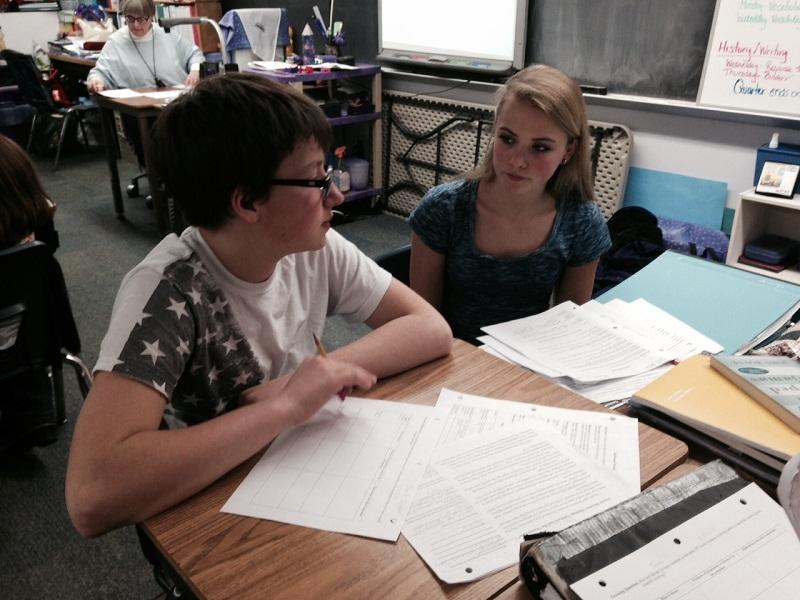 Treed Brooks and Iva Wick, eighth graders at the Newton School in Strafford, discuss key ideas in a reading assignment.