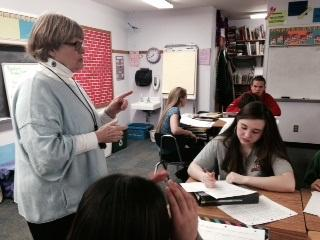 Joanna Hawkins leads eighth graders in classroom activity that supports aims of the Common Core in Strafford's Newton School.