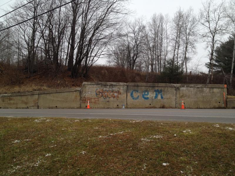 This is what the Londonderry retaining wall looked like before the interim mural was painted.