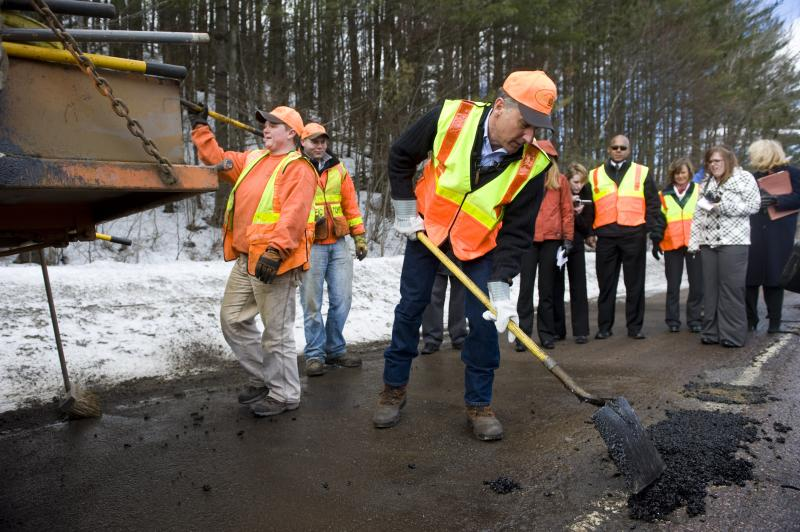 In this April 2011 photo, Gov. Peter Shumlin helps VTrans workers fill potholes during what he then called one of the worst pothole seasons in memory.