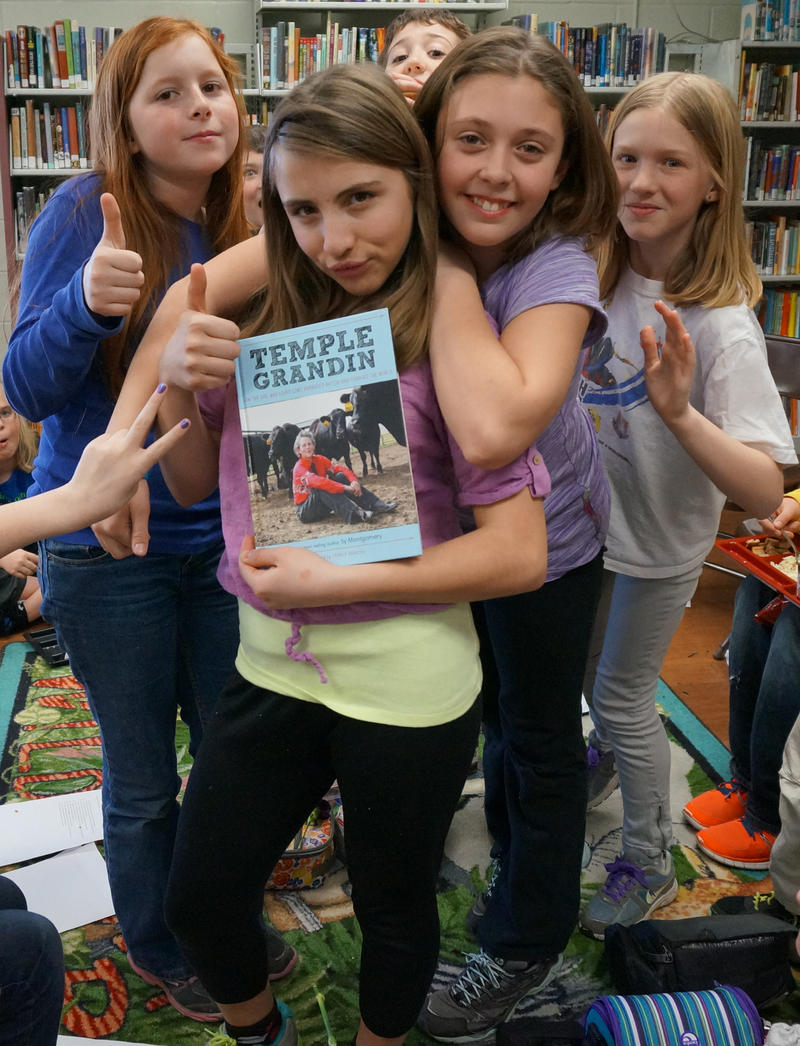 The Wolcott Elementary School DCF Club gives Sy Montgomery's book about Temple Grandin a thumbs up.