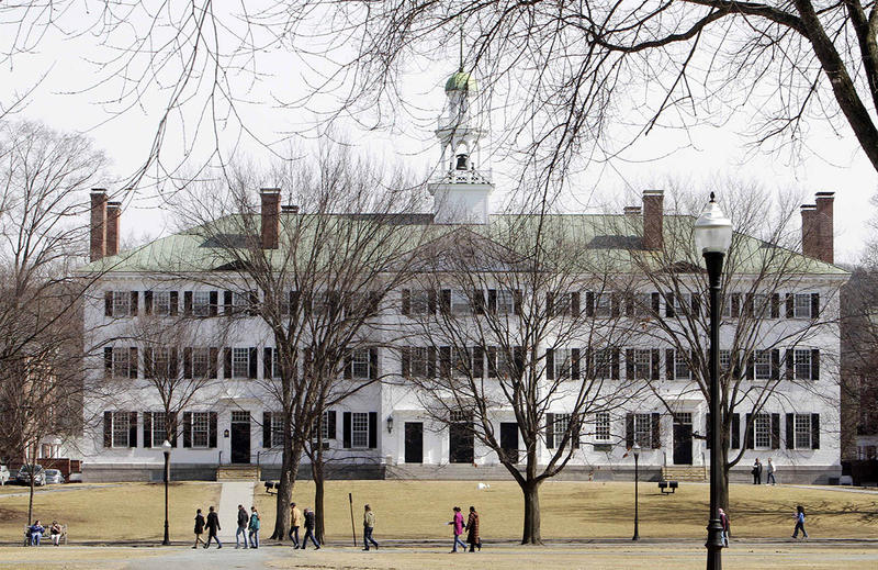 In this 2012 file photo, students walk across the campus of Dartmouth College in Hanover, N.H. The trial of a former Dartmouth rugby player charged with raping a female student began Tuesday at the Grafton County Superior Court.