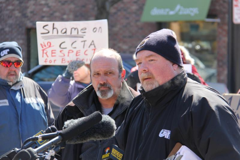 CCTA drivers' steward Mike Walker (right) speaks at a press conference as driver Rob Slingerland looks on.
