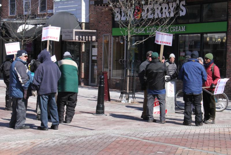 CCTA drivers and advocates picketed across from the bus terminal on Cherry Street in Burlington on Tuesday.
