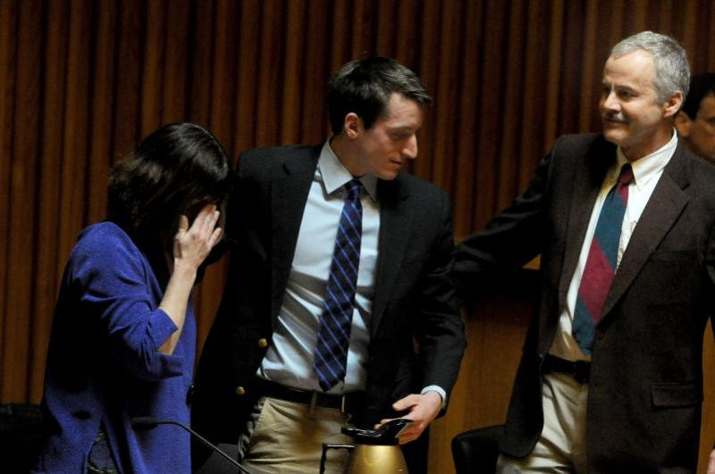 Parker C. Gilbert, center, and his attorneys Cathy Green and George Osler react as the jury finds Gilbert not guitly of five counts of aggravated felonious sexual assault and one count of criminal trespass.