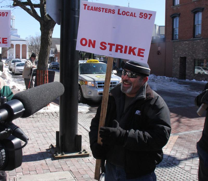 CCTA driver Rob Slingerland joked with fellow drivers before a media interview at the picket line Tuesday.