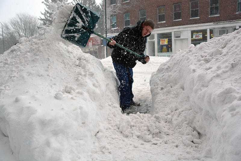Matt Caron digs a path from Pearl Street to the Dunkin' Donuts in Burlington on Thursday morning.