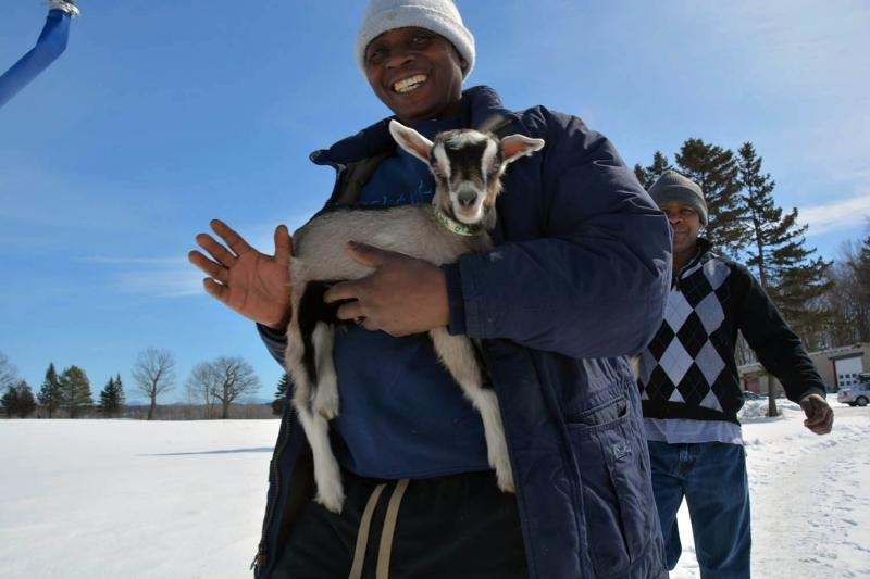 Theogene Mahoro, a Rwandan refugee who recently joined the Vermont Goat Collaborative at Pine Island Farm in Colchester, is one of three refugees raising goats to meet his community's demand for the meat.
