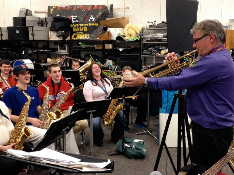 Music Director Glendon Ingalls (in purple shirt with trumpet) leads the Rutland Town School Alumni Band during a recent rehearsal.  The band will perform Friday evening, March 28th in an annual fundraising concert.