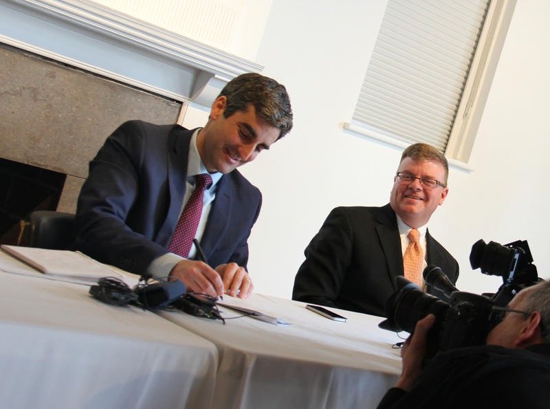 Burlington Mayor Miro Weinberger signed a $6 million bridge financing deal to cover the Burlington Telecom settlement.