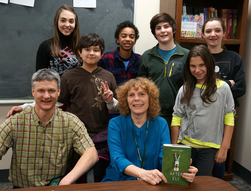 "Stowe Middle School seventh grade teacher Jeff Grogan and author Rebecca Rupp pose with students Emma Hinkson, Shane McGinnis, Ethan Barrett, Noah Levine, Lindsey Singer, Annie Schafer after discussing ""After Eli."""