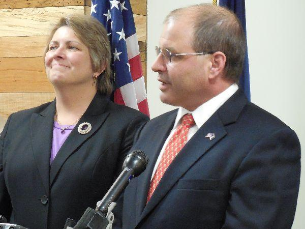 Lawrence Miller, right, and Patricia Moulton at a news conference on Thursday.