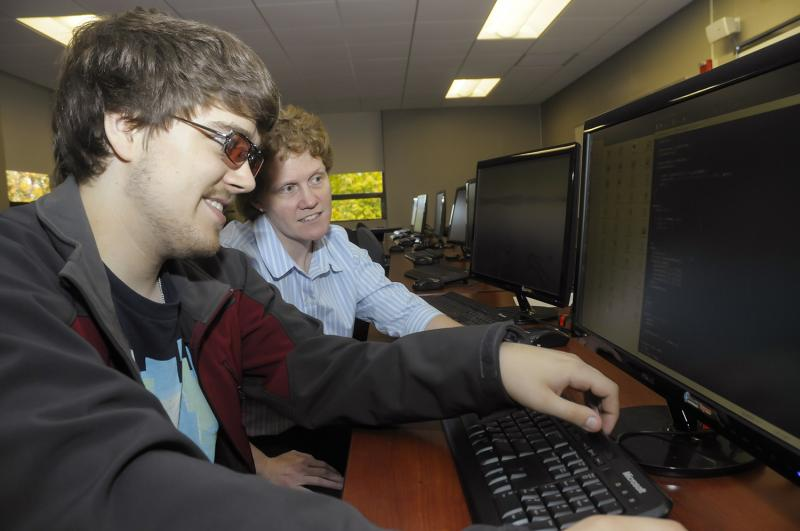 Landmark College student Kyle Vanderwiel, left, works in a computer lab with Professor Michelle Bower, chair of computer science and gaming. The college plants to build a $10 million center for STEM education and research.