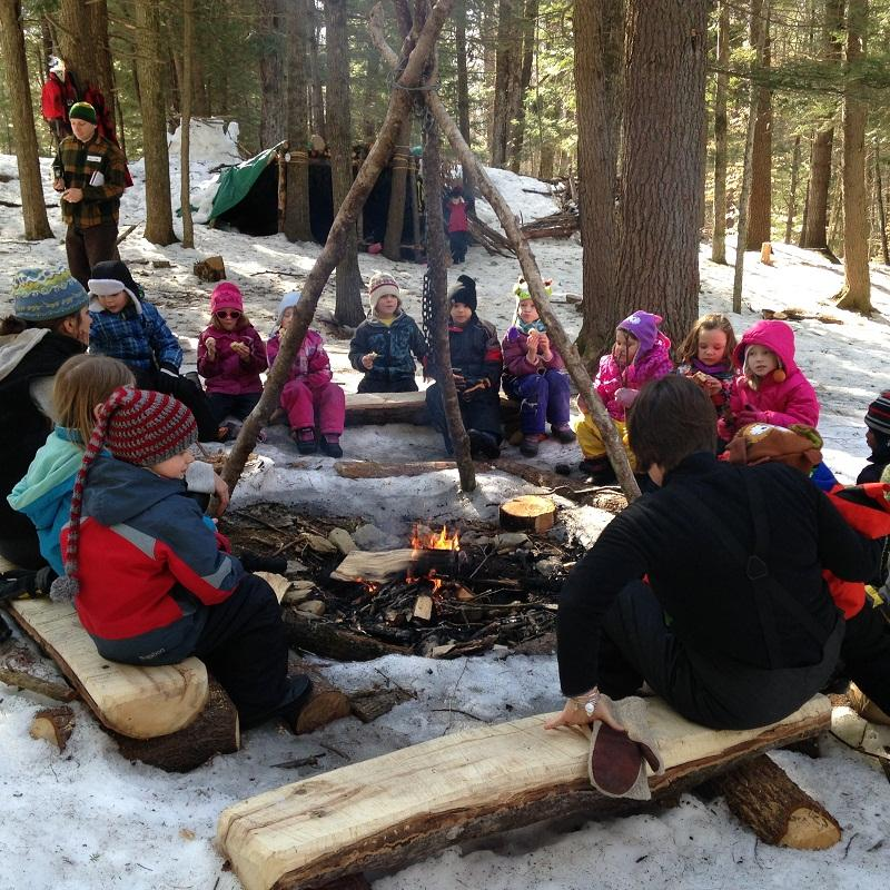 "Kindergarteners warm up by the fire during ""Forest Friday"" in woods near Ottauquechee School."