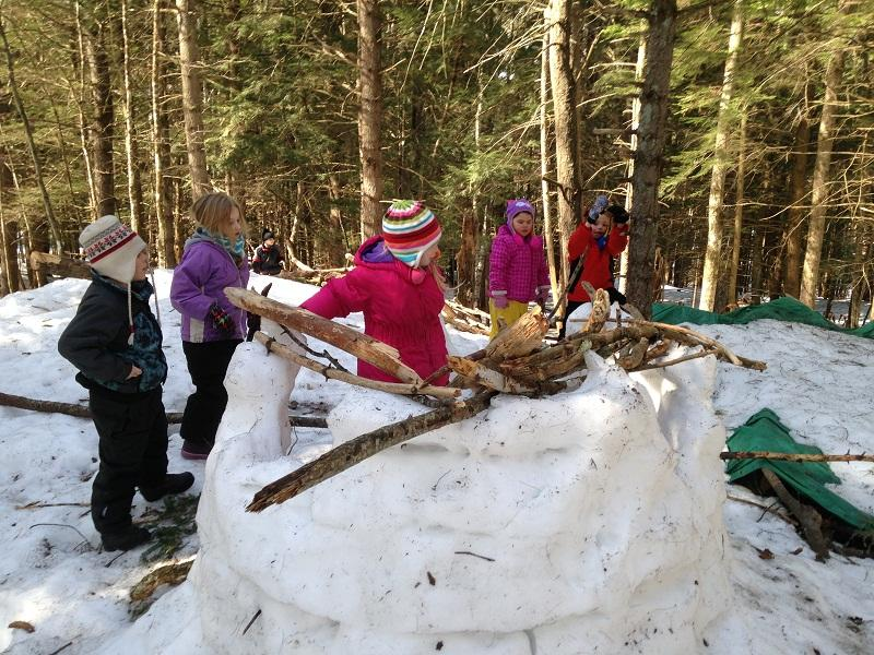"Kindergarteners from Ottauquechee School collaborate on snow fort for ""Forest Friday."""