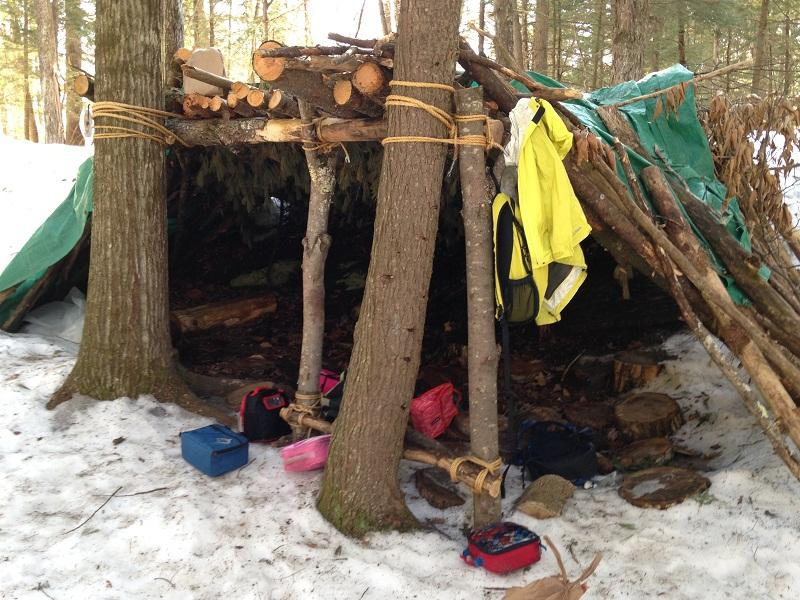 "A home-made shelter doubles as storage for Ottauquechee School kindergarten during ""Forest Friday"" in the woods outside the school."