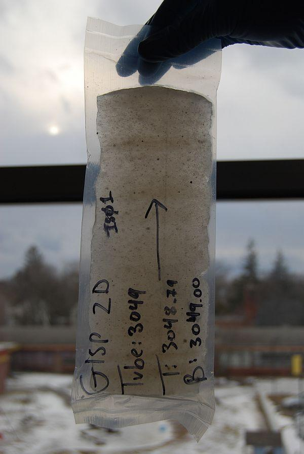 Piece of the GISP2 ice core showing silt and sand embedded in ice. Soon after this picture was taken, the ice was crushed in a University of Vermont clean lab and the sediment was isolated for analysis.