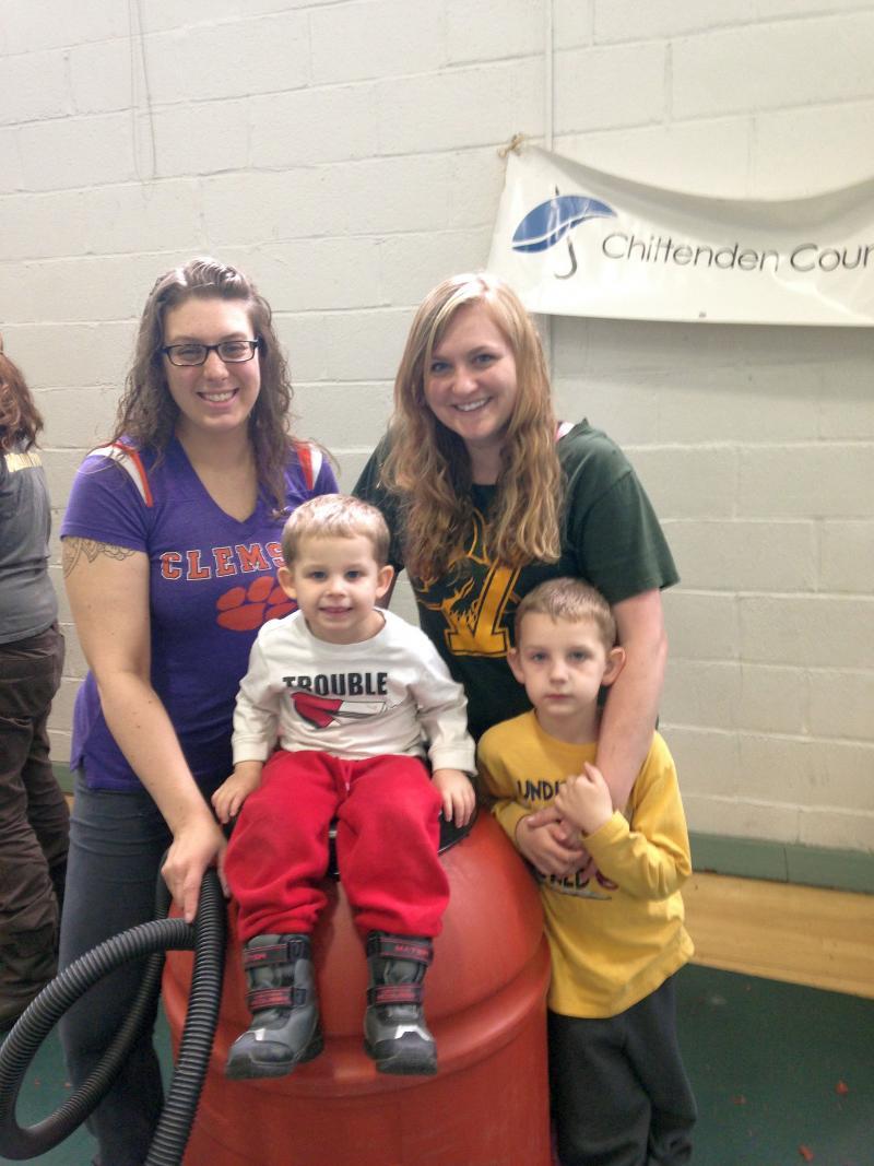 Roommates Lyndsey Eckler and Brittni Simmons build a rain barrel with help from Michael and Nathan Liskowacki.