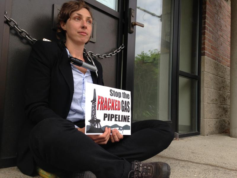 Sara Mehalick sat chained to Vermont Gas headquarters in South Burlington Tuesday morning.