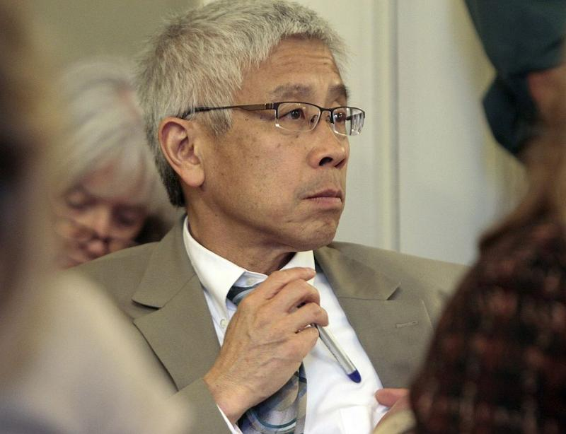 Vt. Health Commissioner Dr. Harry Chen, listening to debate in a legislative committee, May 2012.