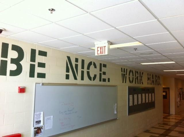 Enosburg Middle School's new motto appears in giant block letters in a school hallway.