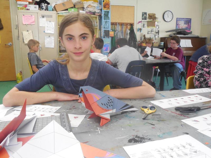 Pia Burke folded a family of passenger pigeons.